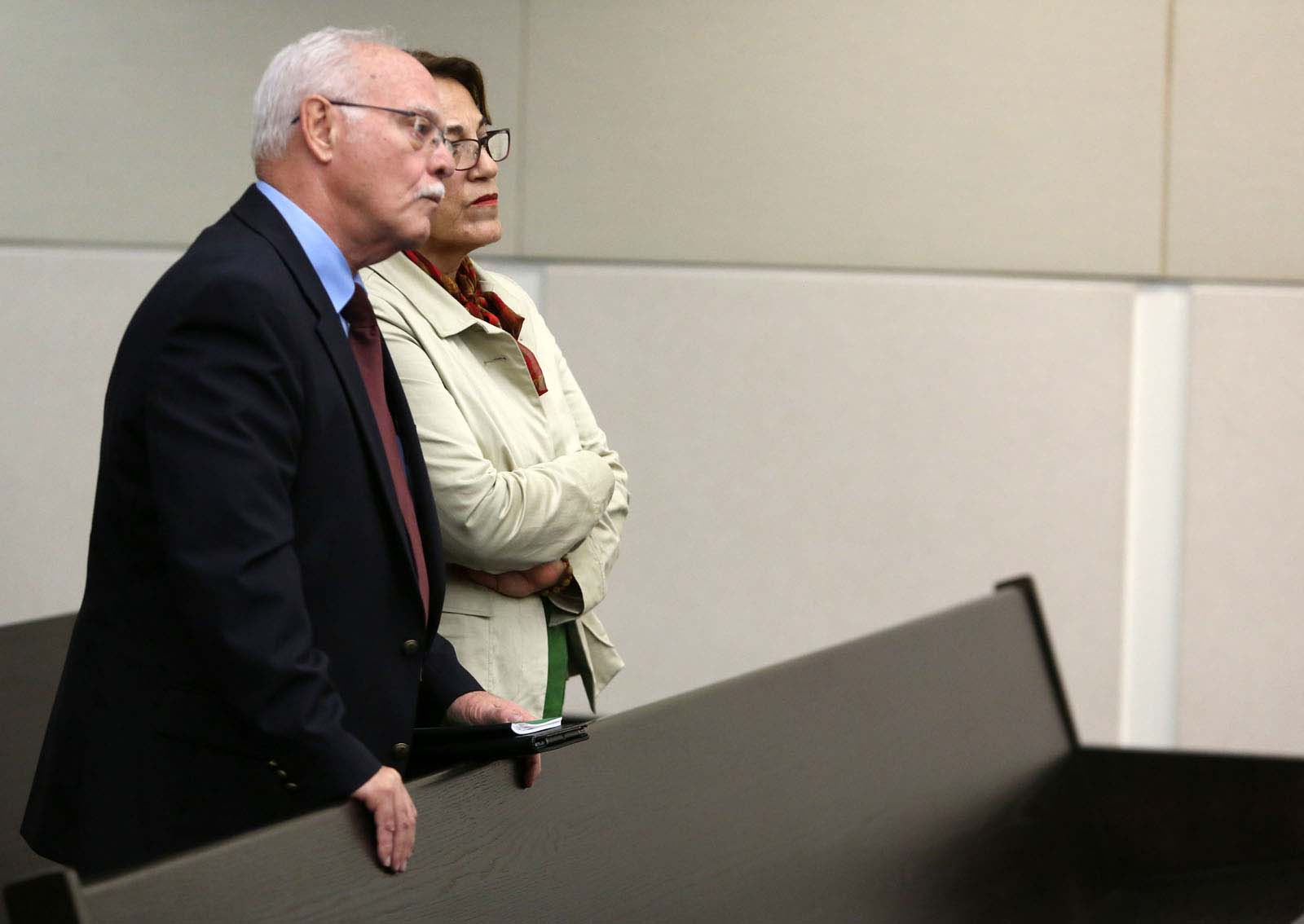Pedro Bravo's parents Pedro Bravo and Azucena Duque listen to instructions from Circuit Court Judge James Colaw to their son about wether or not he should testify Thursday during Bravo's murder trial in courtroom 1B of the Alachua County Criminal Justice Center Wednesday, August 13, 2014.  Bravo is accused of killing University of Florida student Christian Aguilar.  (Doug Finger/The Gainesville Sun/Pool)
