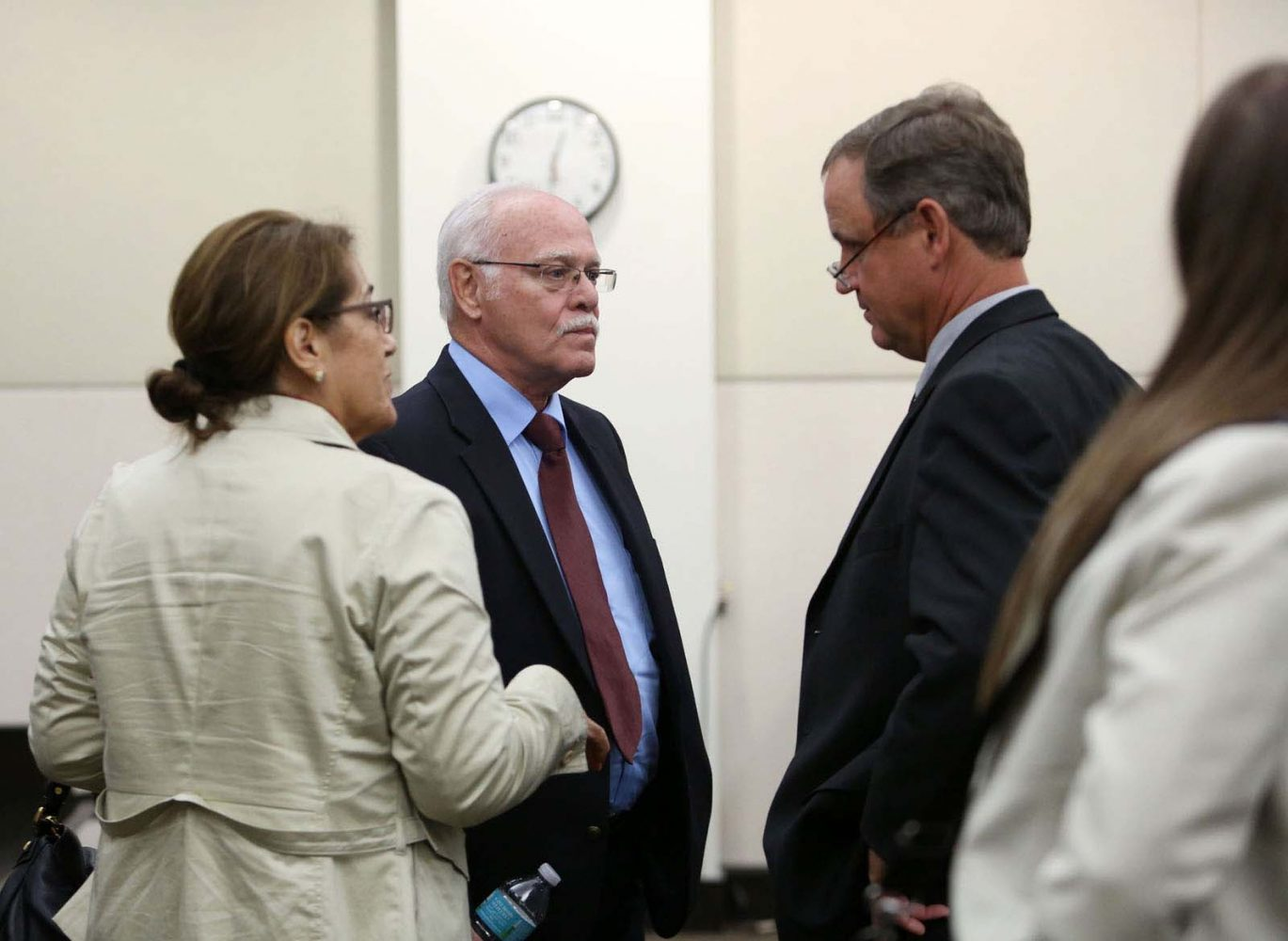 Pedro Bravo's parents Pedro Bravo and Azucena Duque talk with defense attorney Michael Ruppert following day seven of their son's murder trial in courtroom 1B of the Alachua County Criminal Justice Center Wednesday, August 13, 2014.  Bravo is accused of killing University of Florida student Christian Aguilar.  (Doug Finger/The Gainesville Sun/Pool)