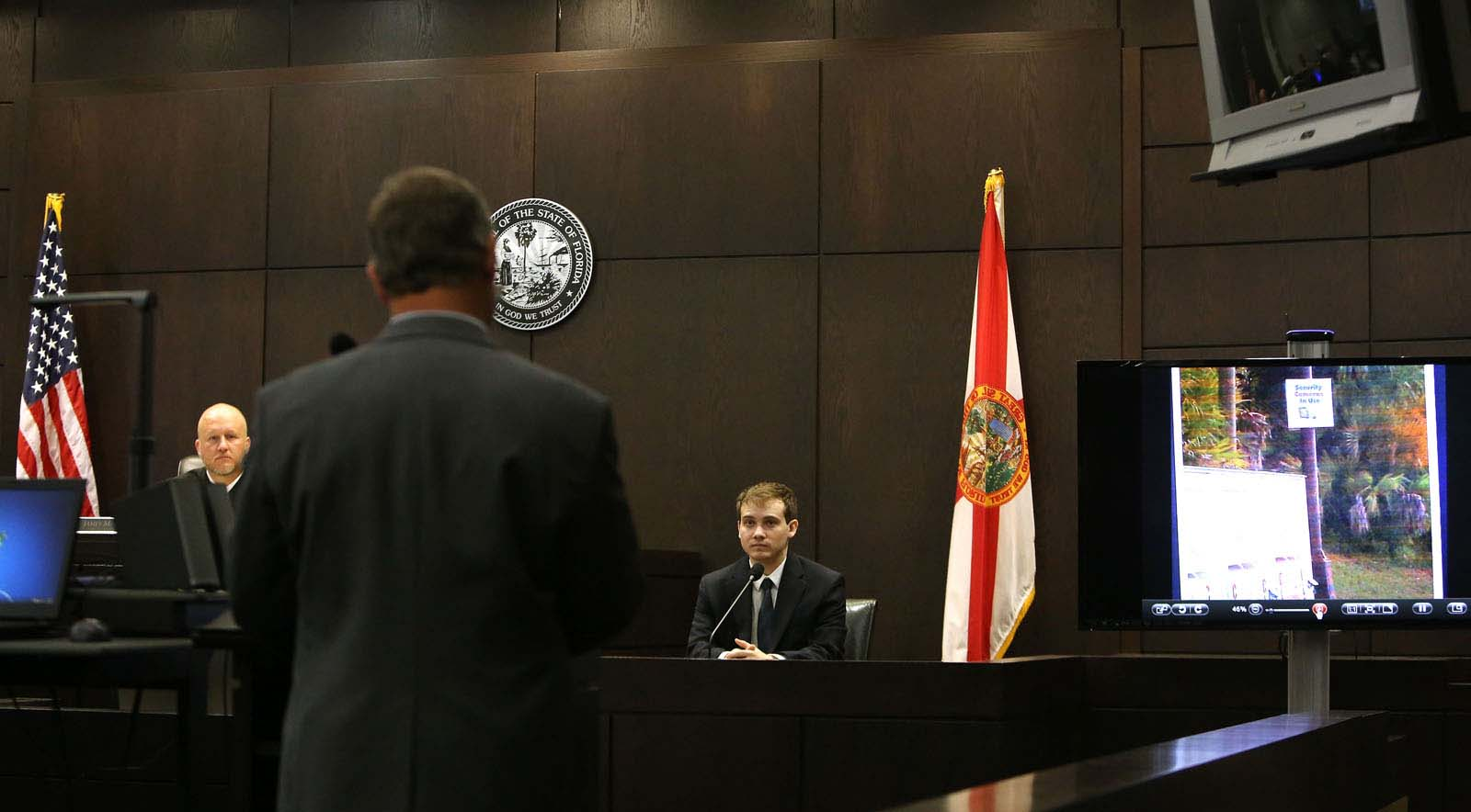 Pedro Bravo testifies before defense attorney Michael Ruppert during Bravo's murder trial in courtroom 1B of the Alachua County Criminal Justice Center Thursday, August 14, 2014.  Bravo is accused of killing University of Florida student Christian Aguilar.  (Doug Finger/The Gainesville Sun/Pool)