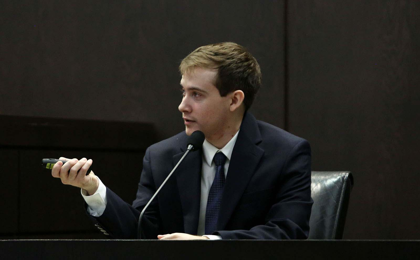 Pedro Bravo testifies on the witness stand during his murder trial in courtroom 1B of the Alachua County Criminal Justice Center Thursday, August 14, 2014.  Bravo is accused of killing University of Florida student Christian Aguilar.  (Doug Finger/The Gainesville Sun/Pool)