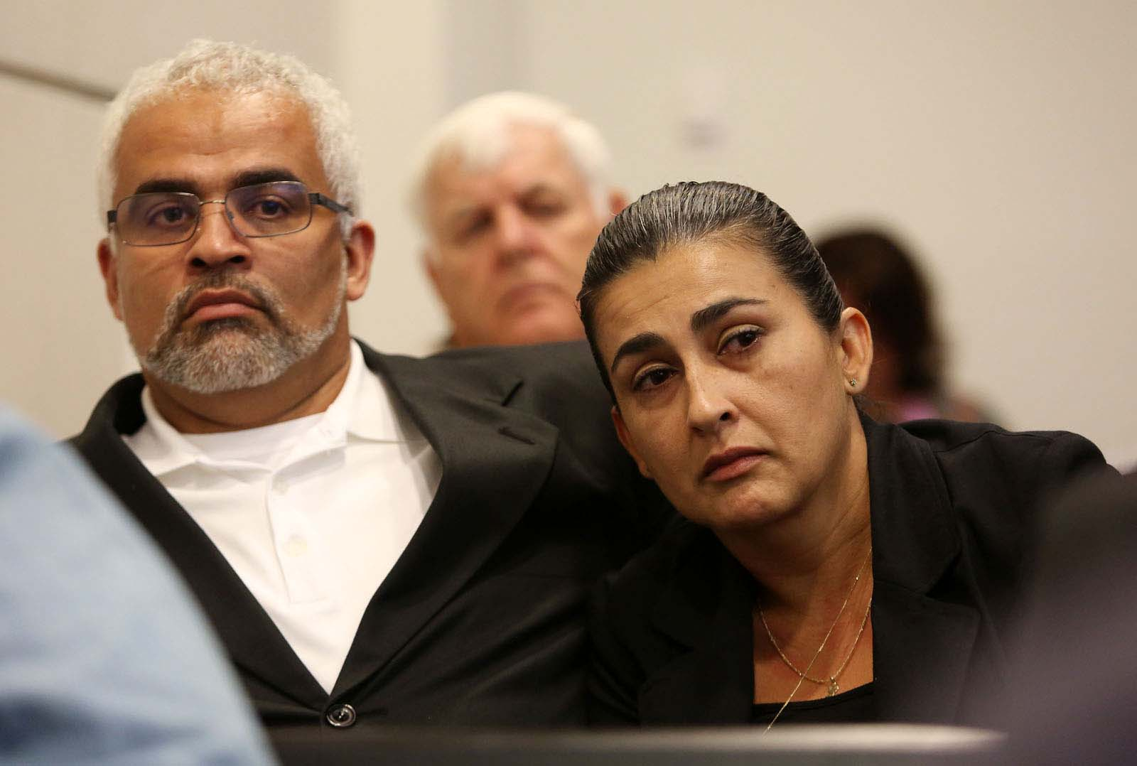 Carlos and Claudia Aguilar, the parents of slain University of Florida student Christian Aguilar, listen to defendant Pedro Bravo testify during Bravo's murder trial in courtroom 1B of the Alachua County Criminal Justice Center Thursday, August 14, 2014.  Bravo is accused of killing University of Florida student Christian Aguilar.  (Doug Finger/The Gainesville Sun/Pool)