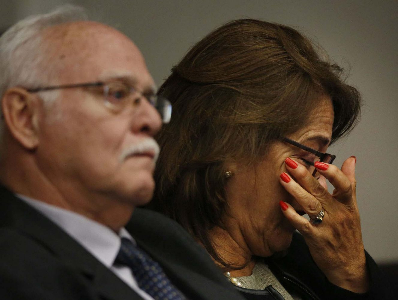 Azucena Duque, the mother of murder defendant Pedro Bravo, wipes tears from her eyes while listening to her son testify that cellmate Michael Angelo threatened his parents if he didn't do what Angelo to him to do during his murder trial in courtroom 1B of the Alachua County Criminal Justice Center Thursday, August 14, 2014.  Bravo is accused of killing University of Florida student Christian Aguilar.  (Doug Finger/The Gainesville Sun/Pool)