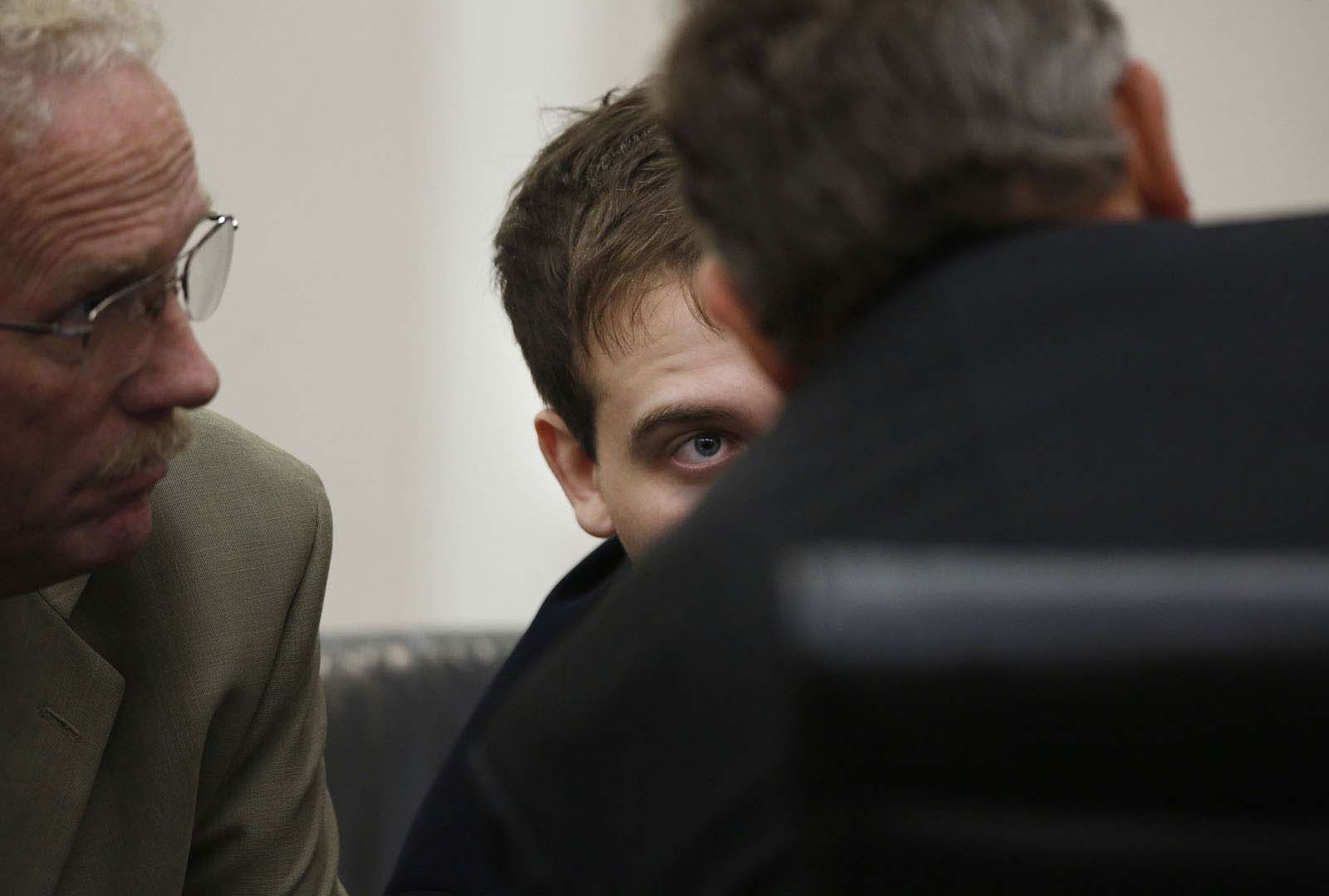 Pedro Bravo talks with his defense team during a break from closing statements by Assistant State Attorney Bill Ezzell during Bravo's murder trial in courtroom 1B of the Alachua County Criminal Justice Center Friday, August 15, 2014.  Bravo is accused of killing University of Florida student Christian Aguilar.  (Doug Finger/The Gainesville Sun/Pool)