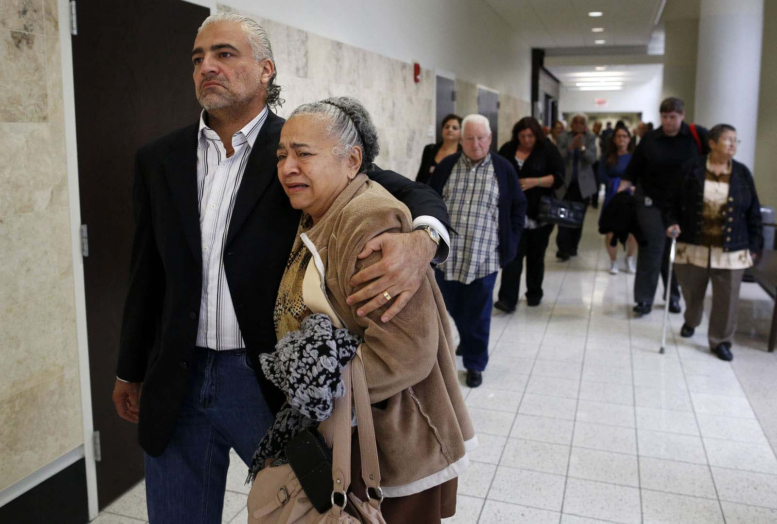 Diego Aguilar, the uncle of slain University of Florida student Christian Aguilar, comforts his mother Maricela Aguilar, Christian's grandmother, as the family leaves the courtroom for a lunch break during Bravo's murder trial in courtroom 1B of the Alachua County Criminal Justice Center Friday, August 15, 2014.  Bravo is accused of killing University of Florida student Christian Aguilar.  (Doug Finger/The Gainesville Sun/Pool)