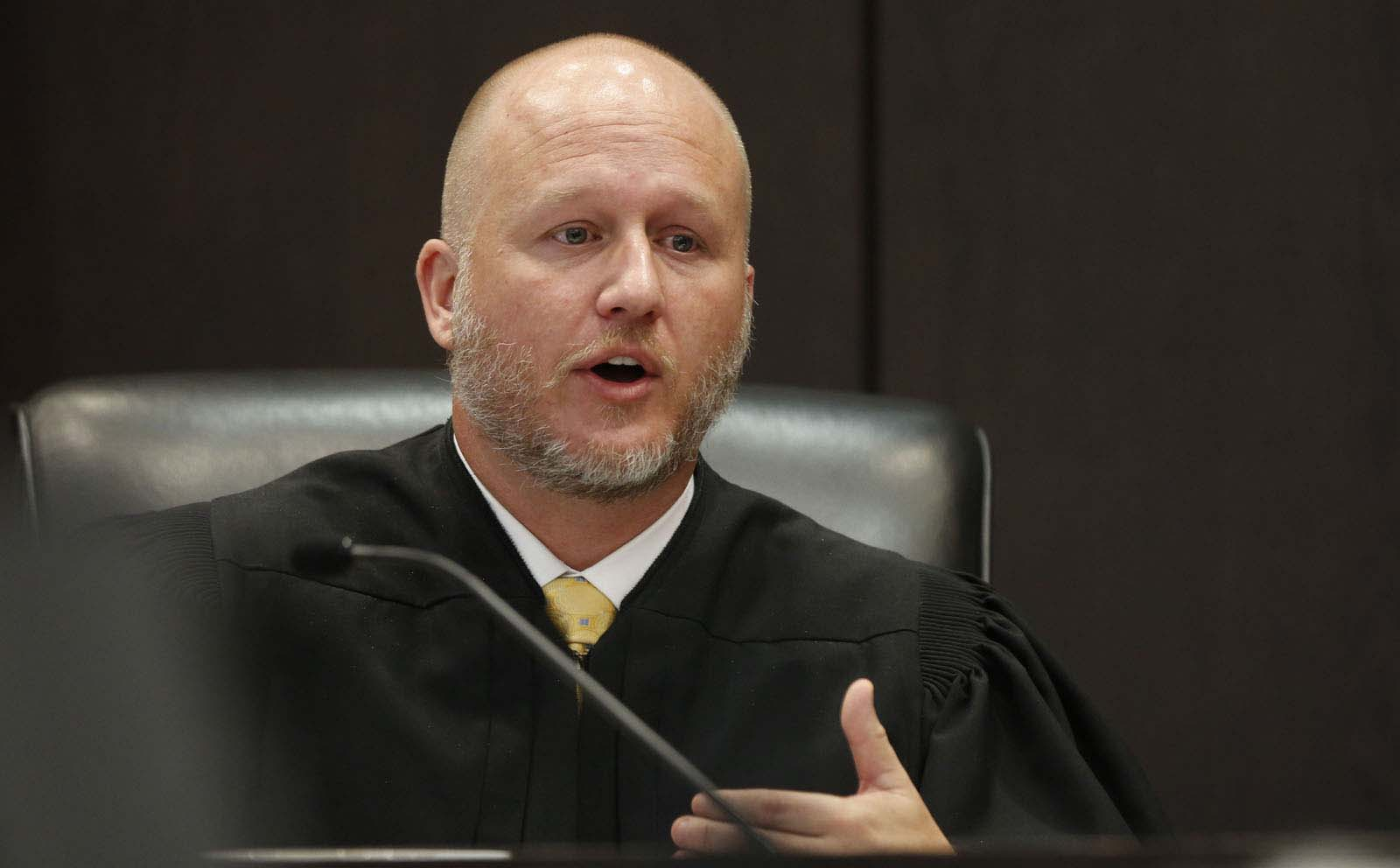 Circuit Court Judge James Colaw reads jury instructions during Pedro Bravo's murder trial in courtroom 1B of the Alachua County Criminal Justice Center Friday, August 15, 2014.  Bravo is accused of killing University of Florida student Christian Aguilar.  (Doug Finger/The Gainesville Sun/Pool)
