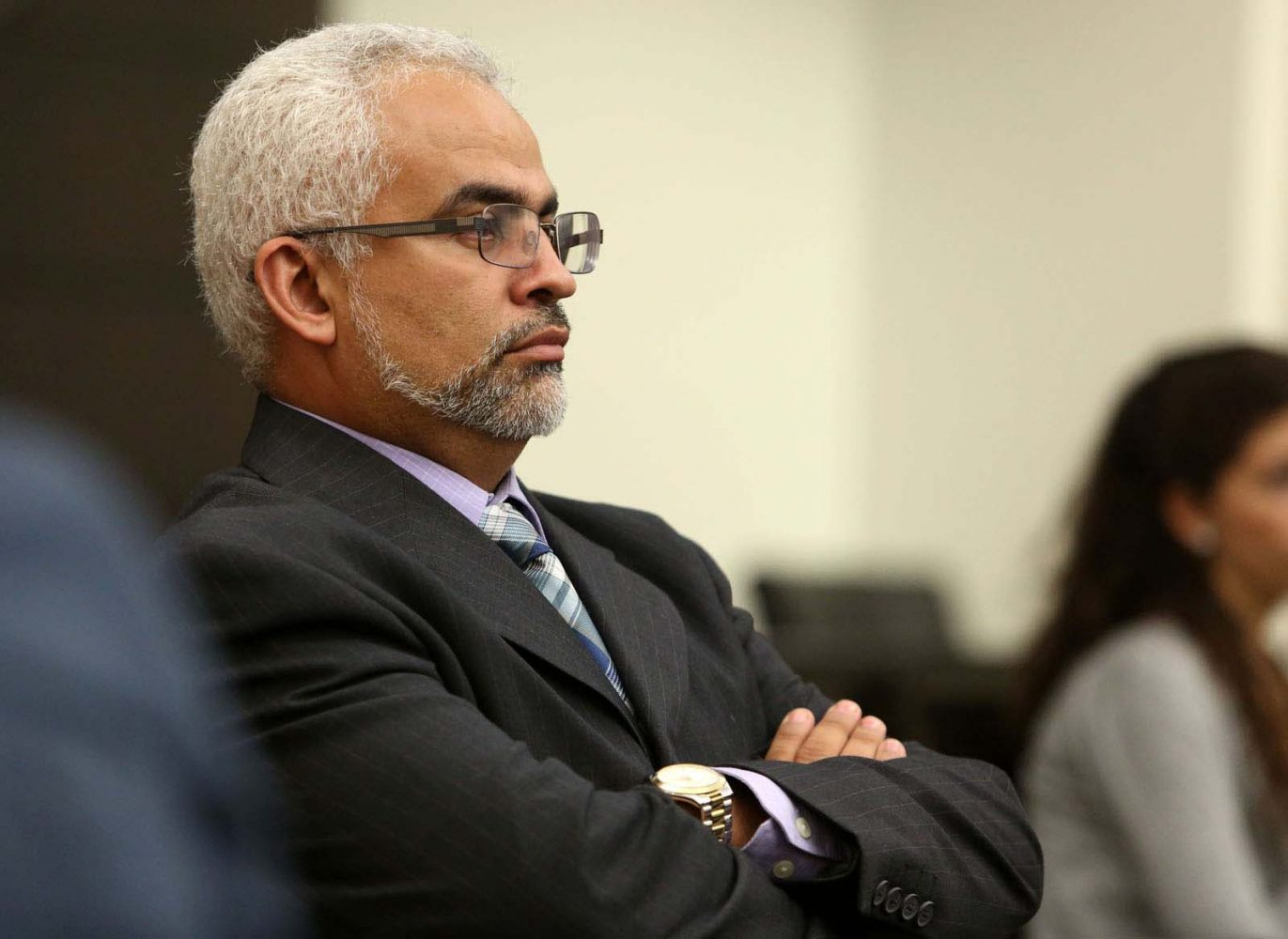 Carlos Aguilar, the father of slain University of Florida student Christian Aguilar, listens to jury instructions for Pedro Bravo's murder trial in courtroom 1B of the Alachua County Criminal Justice Center Friday, August 15, 2014.  Bravo is accused of killing Christian Aguilar.  (Doug Finger/The Gainesville Sun/Pool)