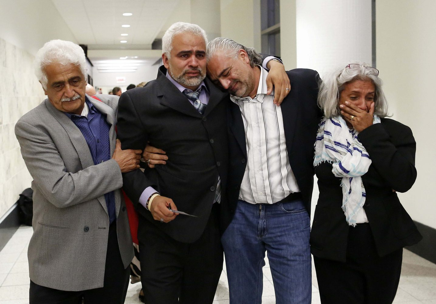 Carlos Aguilar, the father of slain University of Florida student Christian Aguilar, walks with his father Carlos, at left, his brother Diego Aguilar and Diego's wife Nasly, at right, after Pedro Bravo was found guilty of first degree murder and false imprisonment at the Alachua County Criminal Justice Center Friday, August 15, 2014. (Doug Finger/The Gainesville Sun/Pool)