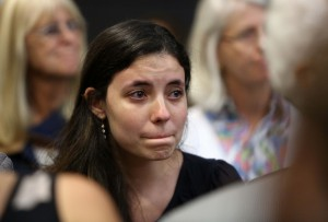 Erika Friman, the former girlfriend of Pedro Bravo and Christian Aguilar, listens to Circuit Court Judge James Colaw sentence Bravo to life in prison for the murder of Christian Aguilar in courtroom 1B of the Alachua County Criminal Justice Center Friday, August 15, 2014. (Doug Finger/The Gainesville Sun/Pool)