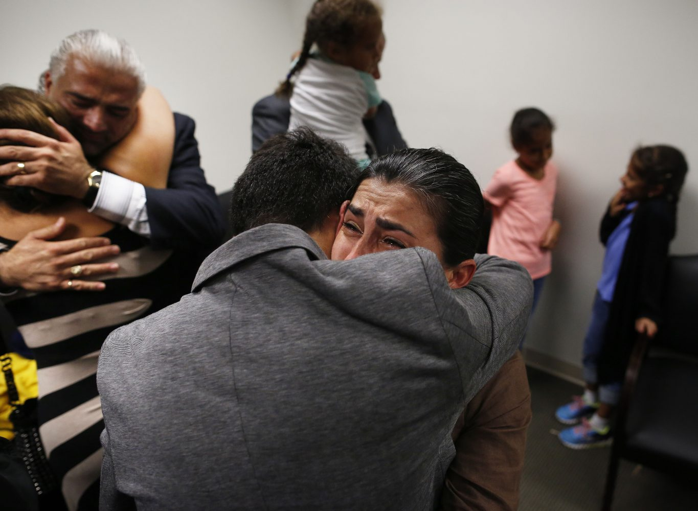 Claudia Aguilar, the mother of slain University of Florida student Christian Aguilar, hugs her son Alex in the family's private room at the Alachua County Criminal Justice Center following the guilty verdict of Pedro Bravo Friday, August 15, 2014.  Bravo was found guilty of first degree murder. (Doug Finger/The Gainesville Sun/Pool)