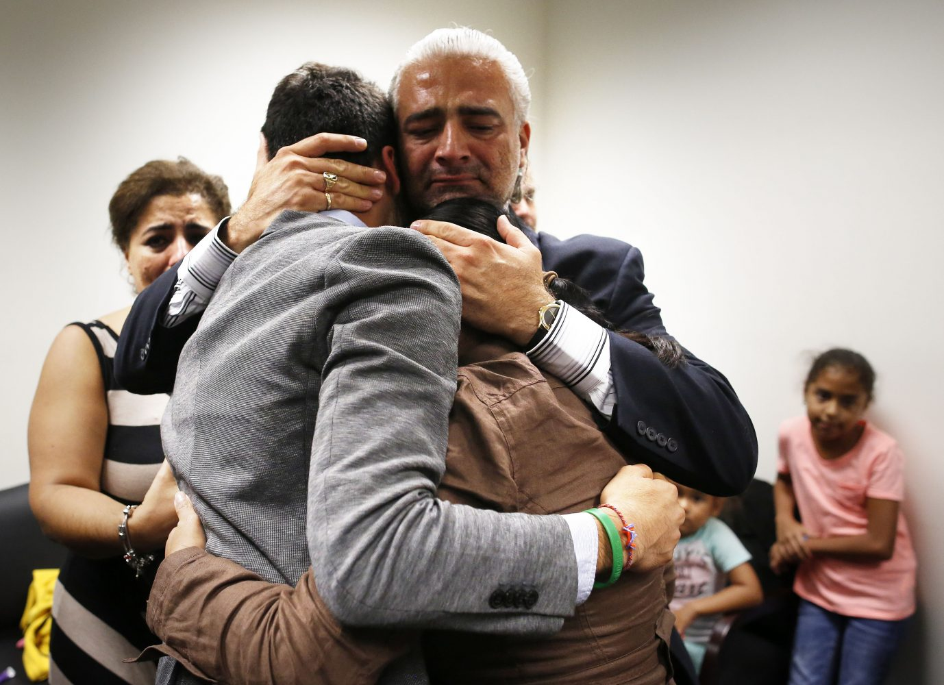Diego Aguilar, the uncle of slain University of Florida student Christian Aguilar, hugs his nephew Alex, Christian's younger brother and Christian's mother Claudia, in the family's private room at the Alachua County Criminal Justice Center following the guilty verdict of Pedro Bravo Friday, August 15, 2014.  Bravo was found guilty of first degree murder. (Doug Finger/The Gainesville Sun/Pool)