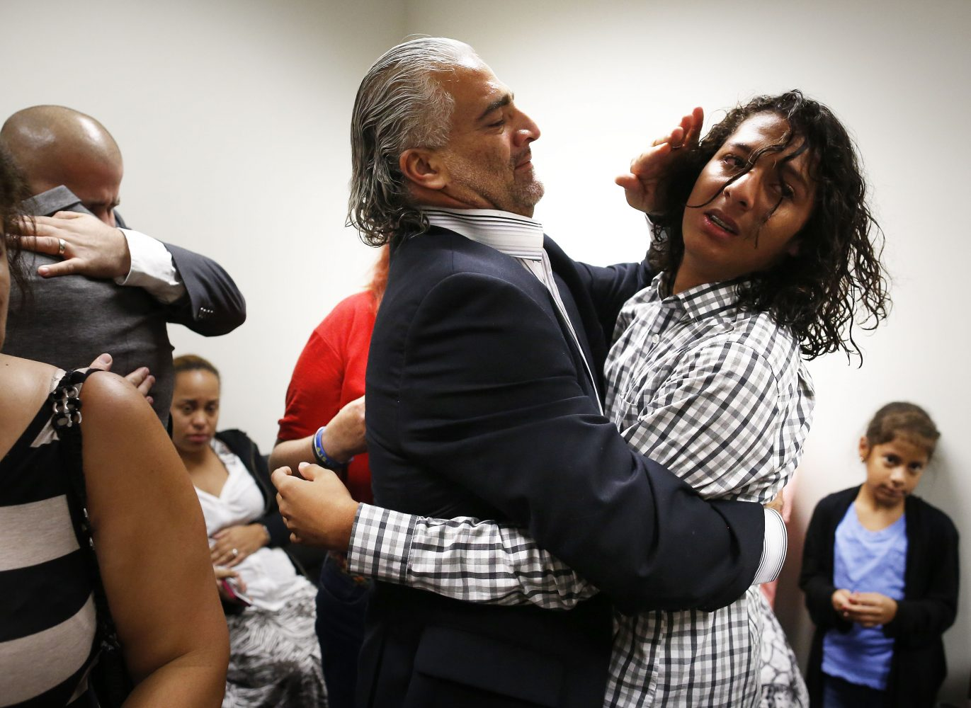 Diego Aguilar, the uncle of slain University of Florida student Christian Aguilar, hugs his son Diego in the family's private room following the guilty verdict of Pedro Bravo at the Alachua County Criminal Justice Center Friday, August 15, 2014.  Bravo was found guilty of first degree murder. (Doug Finger/The Gainesville Sun/Pool)