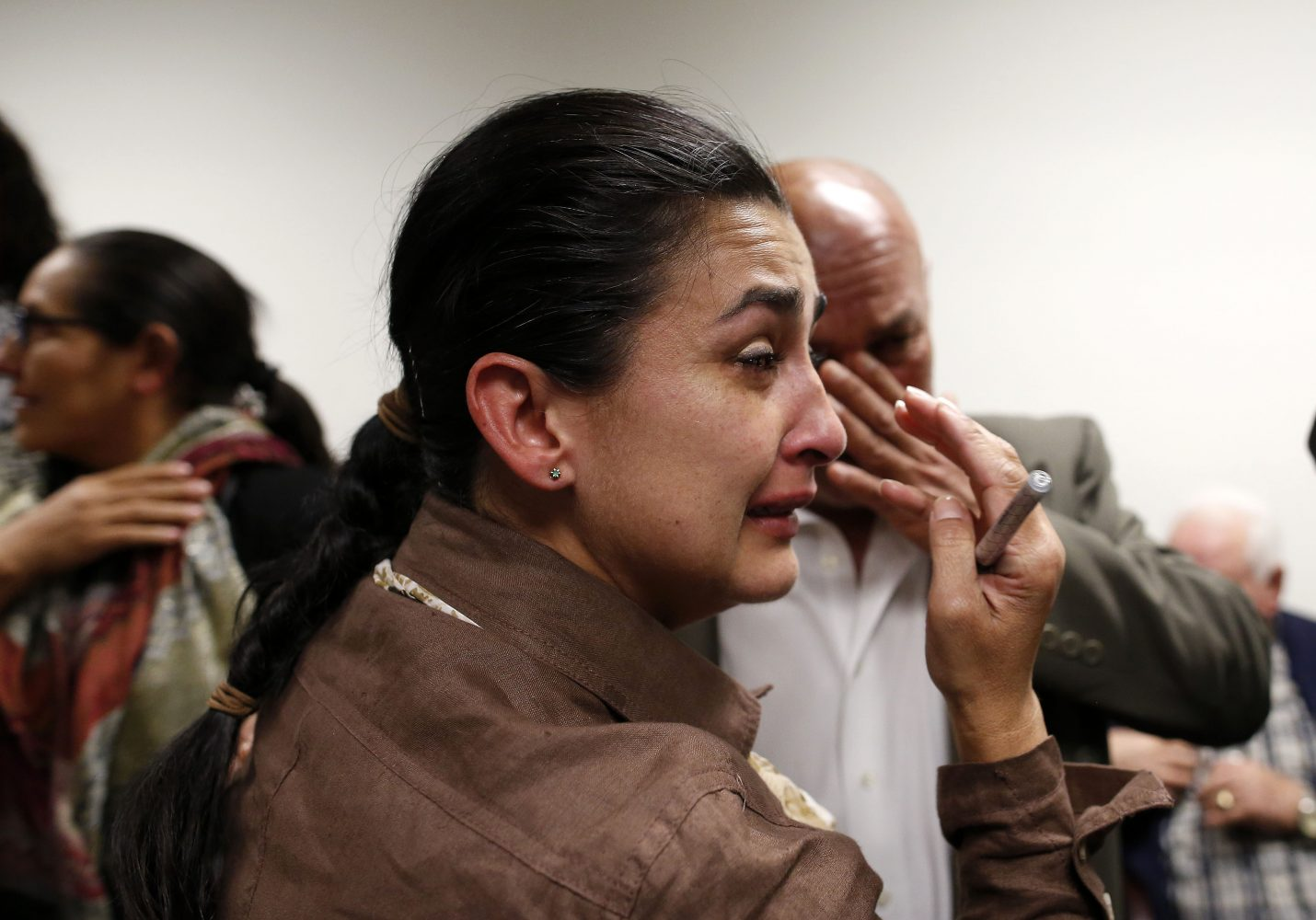 Claudia Aguilar, the mother of slain University of Florida student Christian Aguilar, cries with family in the family's private room at the Alachua County Criminal Justice Center following the guilty verdict of Pedro Bravo Friday, August 15, 2014.  Bravo was found guilty of first degree murder. (Doug Finger/The Gainesville Sun/Pool)