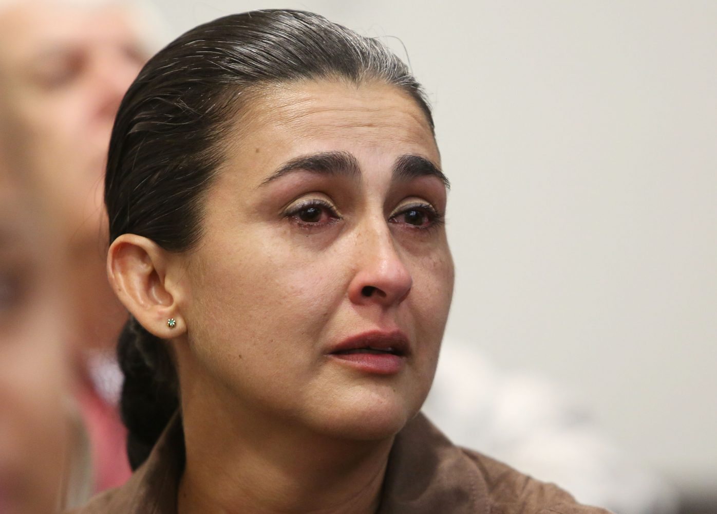 Claudia Aguilar, the mother of slain University of Florida student Christian Aguilar, listens as a guilty verdict is read to Pedro Bravo in courtroom 1B of the Alachua County Criminal Justice Center Friday, August 15, 2014.  Bravo was found guilty of first degree murder. (Doug Finger/The Gainesville Sun/Pool)