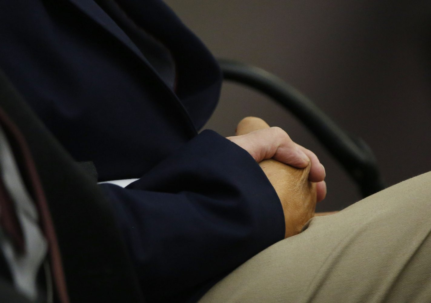Pedro Bravo's parents, Pedro Bravo and Azucena Duque, hold hands before the jury verdict is read to their son in courtroom 1B of the Alachua County Criminal Justice Center Friday, August 15, 2014.  Bravo is accused of killing University of Florida student Christian Aguilar.  (Doug Finger/The Gainesville Sun/Pool)