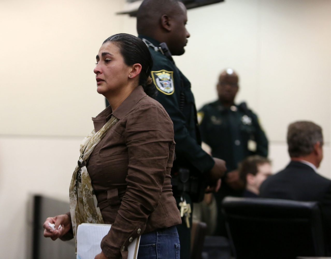 Claudia Aguilar, the mother of Christian Aguilar, walks back to the gallery after speaking to Circuit Court Judge James Colaw before Pedro Bravo's sentencing for the first degree murder of her son Christian in courtroom 1B of the Alachua County Criminal Justice Center Friday, August 15, 2014.  (Doug Finger/The Gainesville Sun/Pool)