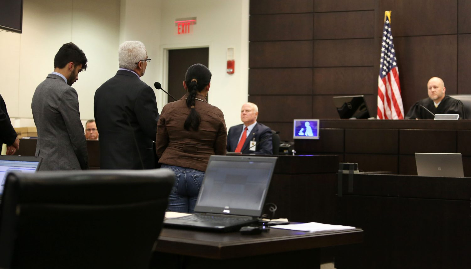 Carlos and Claudia Aguilar, the parents of Christian Aguilar, and their son Alex speak to Circuit Court Judge James Colaw before Pedro Bravo's sentencing for the first degree murder of Christian in courtroom 1B of the Alachua County Criminal Justice Center Friday, August 15, 2014.  (Doug Finger/The Gainesville Sun/Pool)