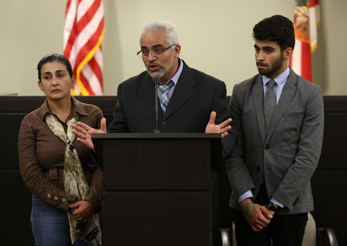 Claudia and Carlos Aguilar and their son Alex speak during a press conference following the first degree murder conviction and life sentencing of Pedro Bravo for the murder of their oldest son Christian at the Alachua County Criminal Justice Center Friday, August 15, 2014.  (Doug Finger/The Gainesville Sun/Pool)