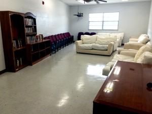 Recreation room in the new dorm with books and television