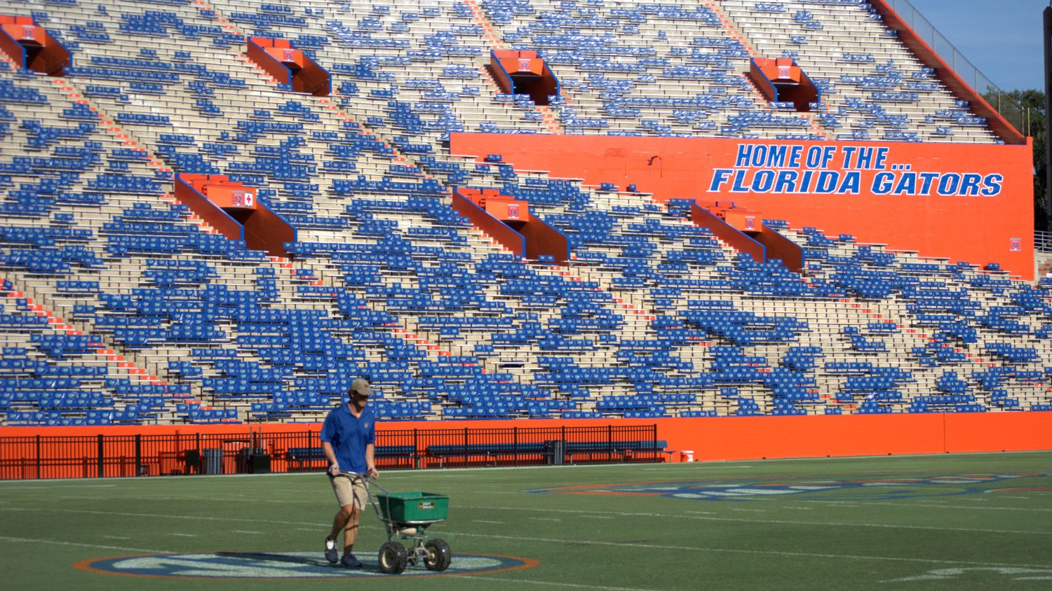 On Monday, Sept. 1, 24-year-old turf groundskeeper John Wagnon fertilizes the Ben Hill Griffin Stadium after UF's opening game against Idaho was canceled on Saturday. The game was called after severe weather caused significant delays and left the field unsafe.
