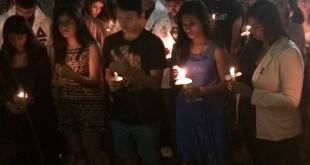 Community members take part in a candlelight vigil in remembrance of Sept. 11.