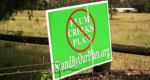 Signs like this one show residents of Hawthorne have serious concerns with Plum Creek Timber Company's plans for development in the area.