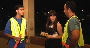 """Walk Safe"" volunteers discuss the safest routes to use when walking students on campus."