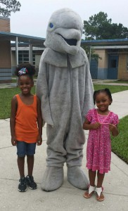 Students of Lake Forest Elementary pose with a dolphin character, who has since become the school's mascot thanks to the Match Challenged sponsored by the Alachua County Education Foundation.