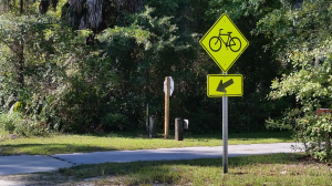 This bike sign is the only sign a driver sees before approaching the road and trail intersection on the Hawthorne Trail. The expansion project includes new signs, according to Mayor of Hawthorne Matthew Surrency.