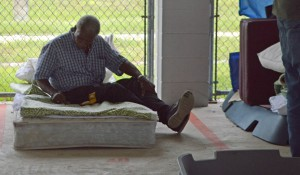 Calvin Council, 64, sits on a mattress under the pavilion at Grace Marketplace on Wednesday.