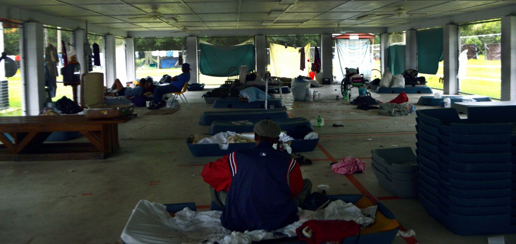 Residents set up their belongings under the pavilion at Grace Marketplace shelter on Wednesday. The shelter, located off Waldo and NE 39th Avenue, provides temporary support for those without concrete living arrangements in Gainesville.