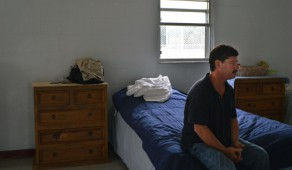 David Brown, 50, sits on his bed in the newly opened Dorm 1 at Grace Marketplace. The shelter opened its first overnight housing option on Wednesday to help those living on the streets transition into more permanent housing.