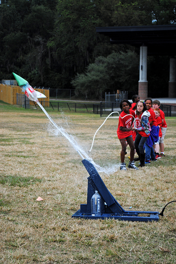 Students from Idylwild Elementary School launch a water rocket at Flavet Field. Fourth and fifth grade students from Idylwild Elementary School visited the University of Florida on Oct. 30 to learn about engineering and other STEM-related studies.
