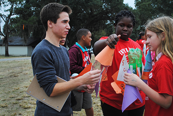 Kurt Renner, 20, a chemical engineering student, talks with students from Idylwild Elementary School at Flavet Field. Fourth and fifth grade students from Idylwild Elementary School visited the University of Florida on Oct. 30 to learn about engineering and other STEM-related studies.