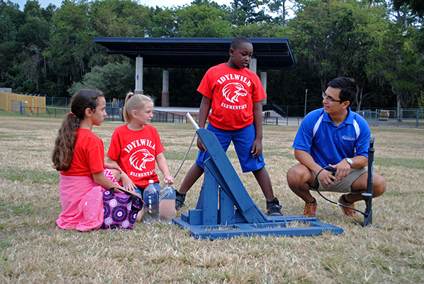 Kenly, Simone and Christopher, students from Idlywild Elementary School, set up a water rocket to launch at Flavet Field. Building water rockets was one of the activities fourth and fifth grade students from Idylwild Elementary School participated in when they visited the University of Florida on Oct. 30.