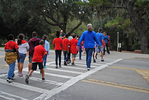 Students from Idylwild Elementary School walk to Flavet Field to launch water rockets. Building water rockets was one of the activities fourth and fifth grade students from Idylwild Elementary School participated in when they visited the University of Florida on Oct. 30.