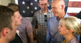 Florida Gov. Rick Scott and his wife, Ann, talk to potentail voters at David's Real Pit BBQ in Gainesville in October 2014. Scott signed 33 bills into law today. (File/WUFT News)