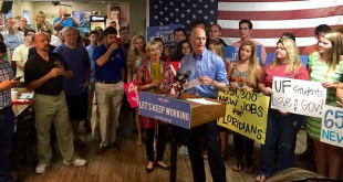 Governor Rick Scott urges attendees of a rally in Gainesville to vote early and to encourage others to do the same. The stop was one of many on a Get Out the Vote bus tour on October 28th, 2014.