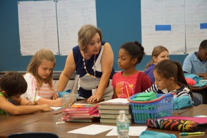 Dunnellon Elementary School's Maria Gonzalez helps her fourth grade students with classwork. She received the Excellence in Education Award earlier this month from Lt. Gov. Carlos Lopez-Cantera as part of Hispanic Heritage Month.