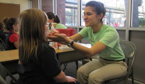 Victoria Rusinov administers FluMist to a child at the Control Flu clinic at Littlewood Elementary School.