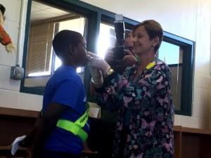 A child participates in the Teach Flu a Lesson program and receives his annual flu vaccination. (PRNewsFoto/Families Fighting Flu)