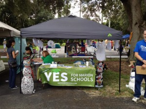 """Yes For Marion County Schools table at the Journey Into Reading event at Central Florida State College. The theme of the event was """"seasons"""" and we were designated as """"winter."""""""