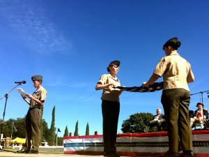 Two Milton Lewis Young Marines fold the American flag during the Alachua County Veterans Day Celebration.
