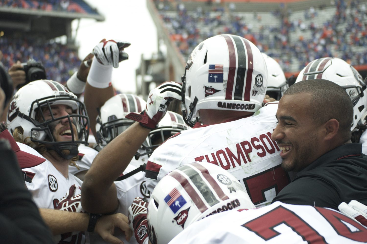 The Gamecocks rush into the endzone to celebrate with their quarterback.