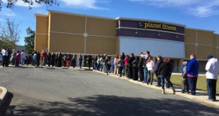Parents of Gainesville High School students line up at Planet Fitness to pick up their students after a bomb threat. Students and staff were evacuated from GHS after a threat was called in around noon.