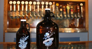 First Magnitude Brewing Company in Gainesville fills growlers in the 32-ounce size (left) and the gallon size (right). A longstanding ban on the popular 64-ounce growler prevents Florida craft breweries from filling or selling containers of that size.