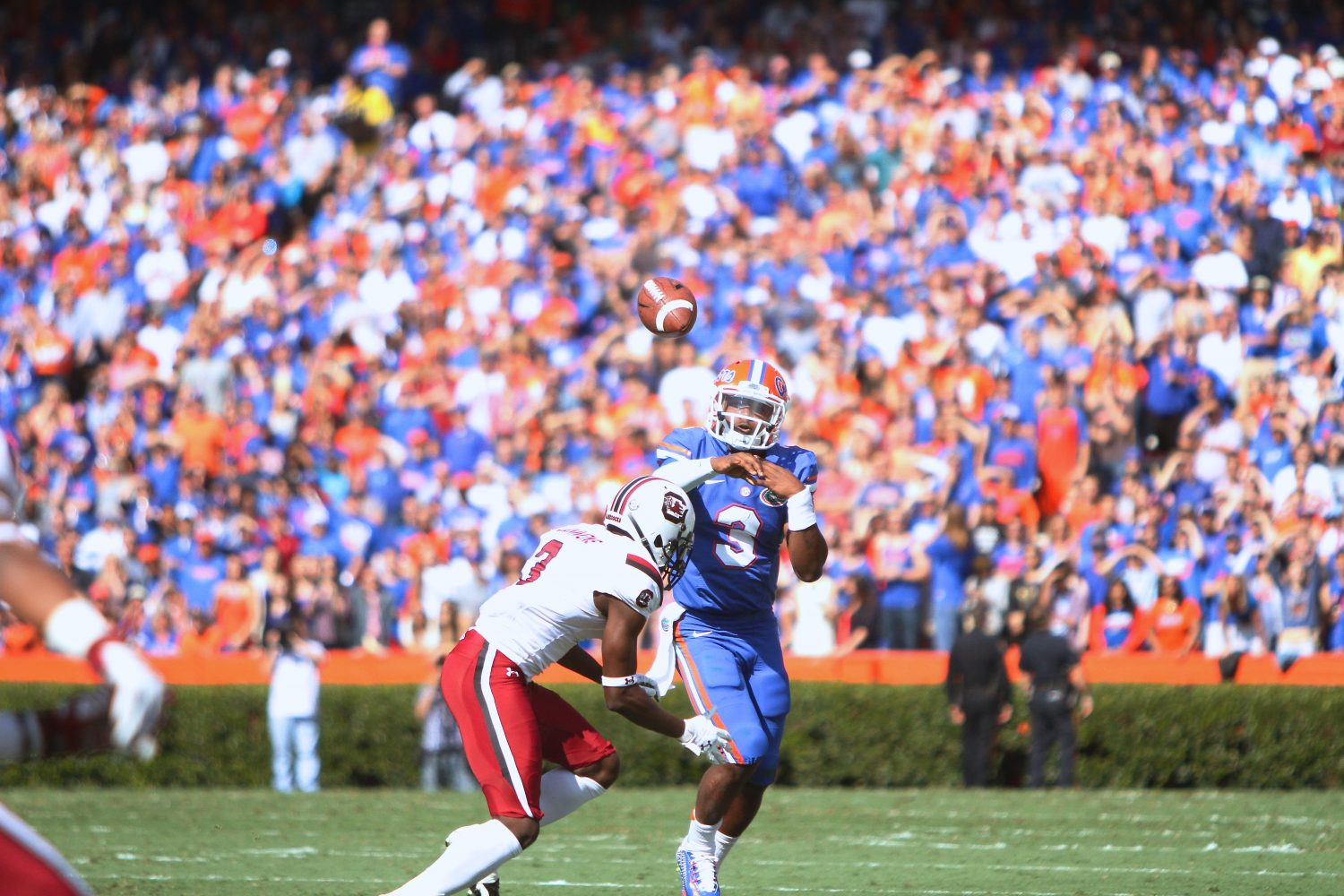 Florida quarter back Treon Harris rolls out to his left, looking for a receiver downfield.