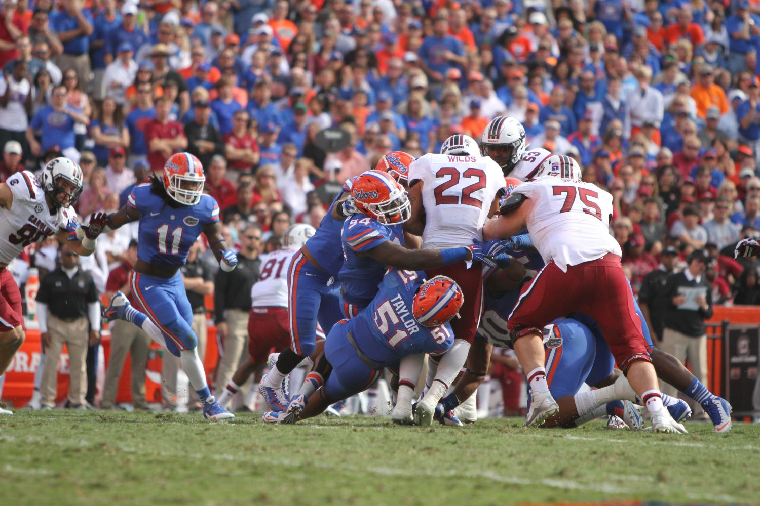 The Gator defense swarms Wilds.