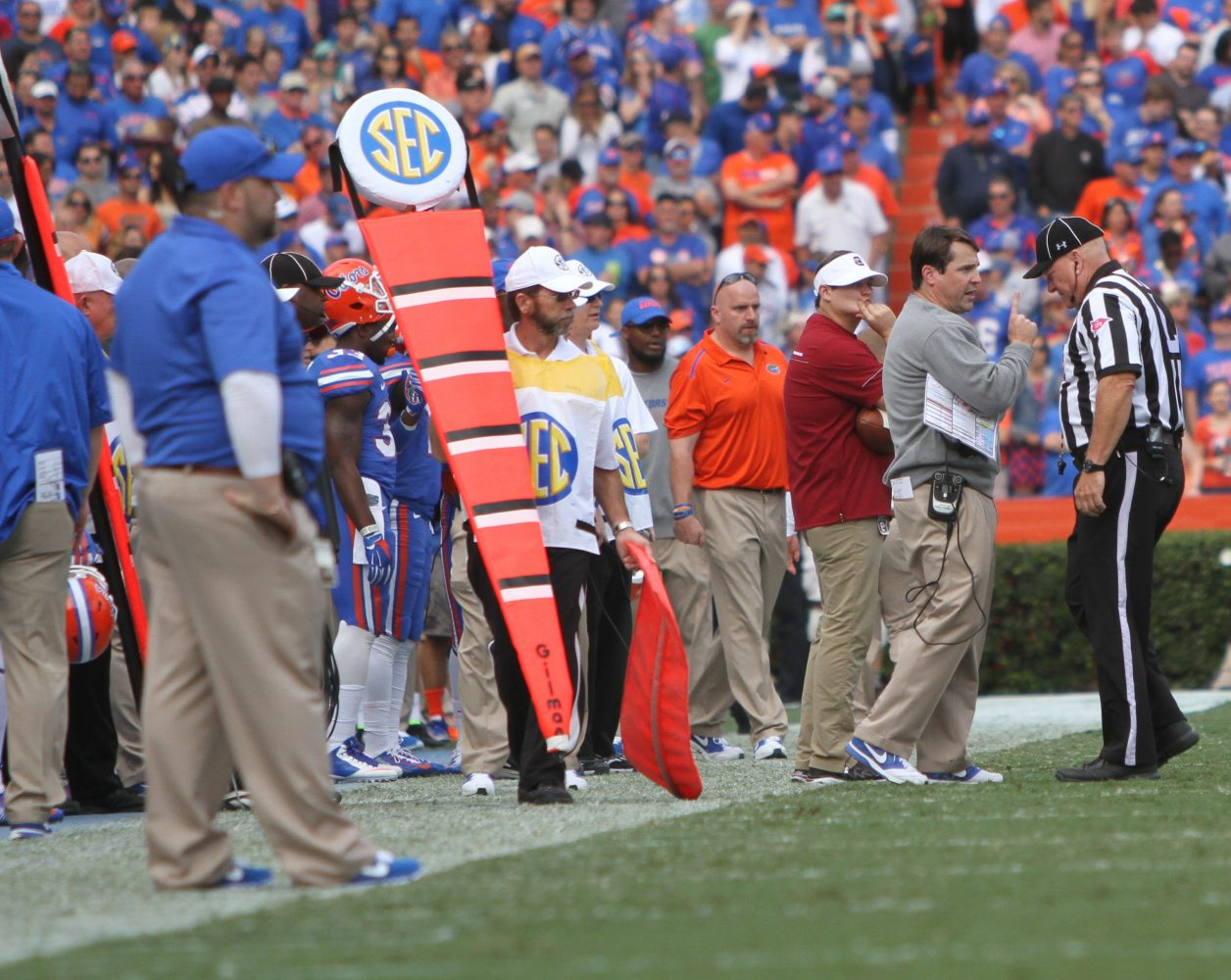 Florida Coach Will Muschamp discusses a previous play with the referee.