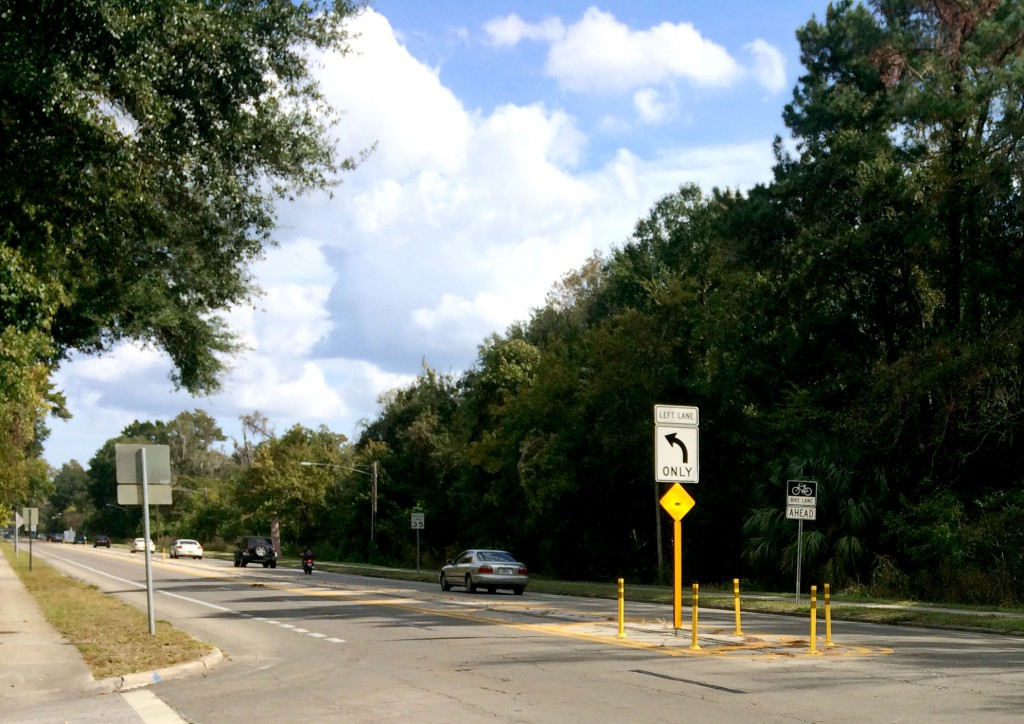 Cars head east on NW 8th Ave. after having to merge from two lanes into one just after passing NW 34th St. on November 6 in Gainesville.