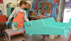 Jeannine Cawthon, a Gainesville native, paints the body of a PET cart on Thursday morning.